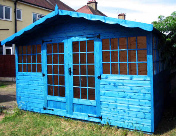 !2 X 8 Georgian chalet garden shed with deeper door windows and treated blue.