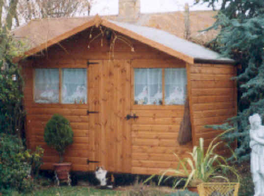 !0 x 6 Chalet style garden shed with extended roof and sides